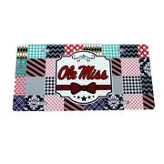 OM QUILTED LICENSE PLATE